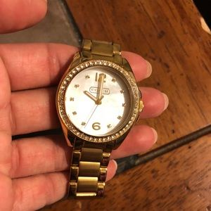 Gold and pearl Coach watch